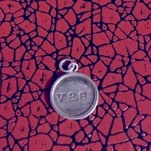 Silver circular charm with monogram v a s